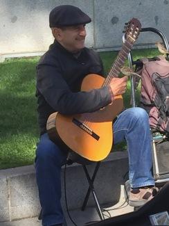 2019-05-09 Guitar player with friends, Prado courtyard, Madrid (photo-Steve Foote)