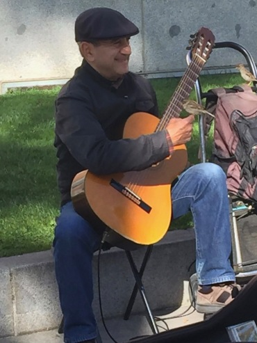 2019-05-09 Guitar player with friends, Prado courtyard, Madrid (photo-Steve Foote)