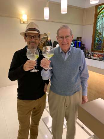 Rick Atkins and Jim Reilly toasting in Spain